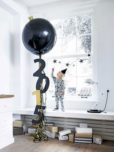 15 Balloons to Make Your New Year's Eve Party Festive AF via Brit + Co