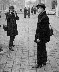 Paul McCartney and John Lennon (John being photographed by Paul)
