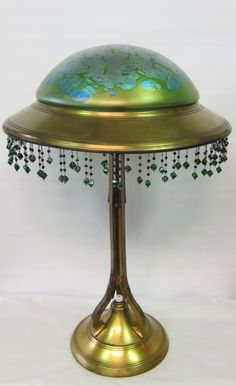 This early 20th century Austrian art nouveau table lamp is from the Goetz factory & has a blue oil spot pattern on a green color dome shape…