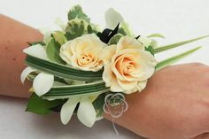 Floral wrist of cream roses and white orchids | Shop Dream Flowers