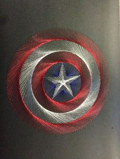 - Hand stitched Captain America Shield logo Hand stitched Captain America Shield logo The -