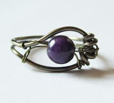 Purple Ring Mountain Jade Wrapped in Gunmetal.    So pretty and such a great idea for a wrapped wire ring!