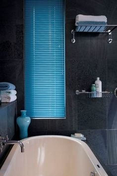 Bright colour can add a brilliant contrast to a darkly decorated room, use accessories in the same colour to complete the look. Made to measure Electric Aqua Aluminium Venetian blinds would be perfect in this room. Great for bathrooms and kitchens