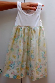 Vintage Pillowcase Tank Dress Okay.  Raid your Grandma's linen closet, or hit up your local Goodwill for a pillowcase.  Grab a basic tank.