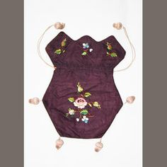 Bonhams. An aubergine silk reticule  Neaty embroidered with floral springs, silk covered acorn shaped tassel heads and the initials 'E.E.'