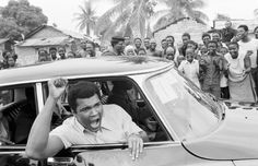 Boxer Muhammad Ali on a sightseeing tour downtown Kinshasa, Zaire September 17, 1974.