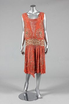 A beaded coral crepe flapper dress, circa 1928, - Kerry Taylor Auction