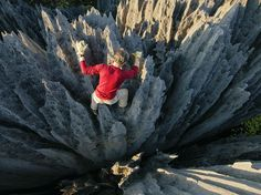 """Climber John """"Razor Sharp"""" Benson weaves through skin-ripping pinnacles. In Malagasy, the formations are called tsingy, meaning """"where one cannot walk barefoot."""" The terrain resists intrusions from hunters, hungry cattle, and wildfires. http://photography.nationalgeographic.com/photography/photo-of-the-day/tsingy-climbing-alvarez/"""