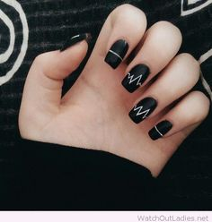 Black nails with white accents