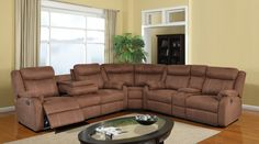 The U9303 Chocolate Reclining Sectional from Global Furniture USA is perfect for entertaining a crowd! Features 4 reclining seats, drop down tray, cup holders, and a storage drawer. A great value!! 3pc Set Includes: Reclining Sofa w/Drop Down Tray Reclining Loveseat w/Console With Storage Drawer Wedge