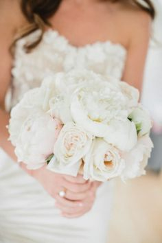 You can't go wrong with a lush bridal bouquet of white and blush peonies.
