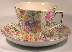 Vintage 1920's Chintz Teacup set features a bouquet of flowers on an earthenware body by Nelson Ware. Made in England. Cup is 2.75 inches high by 3.25 inch diam.