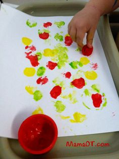 Work on fine motor grasp by pinching and painting with pom poms!