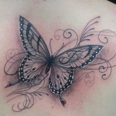 Butterfly and script design tattoo