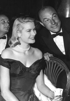 Grace Kelly with Gene Kelly at an industry dinner, 1950s.