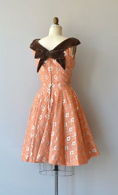 Vintage late 1950s, early 1960s dress in warm apricot with silver metallic lace over layer, off the shoulder bodice trimmed in velvet, fitted waist, shorter length full skirt and metal zipper. --- M E A S U R E M E N T S --- fits like: small (medium with alterations) bust: 34 (bust has been taken in and can be let out to 36 bust) waist: 26 (can be let out to 28) hip: free length: 40.5 brand/maker: n/a condition: excellent ✩ layaway is available for this item To ensure a good fit, please r...