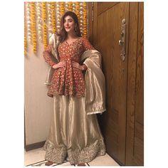 #UrwaHocane stuns in our orange and gold peplum shirt and worked tissue sharara for her wedding dholki #remashehrbano #urwafarhan #wedding #lahore