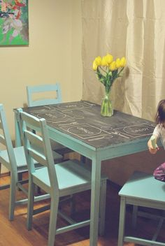 I am doing exactly this to the kids table.  Same colors and all.  Chalkboard table top! Awesome playroom idea.