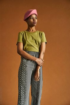 A South African woman wearing traditional Shweshwe print modern clothing shot against a brown background Stylist: Bielle Bellingham Photographer: Micky Wiswedal Hat: Crystal Birch Modern Clothing, Modern Outfits, Female Portrait, African Women, Birch, Stylists, Women Wear, Hat, Crystal