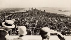 48 Unexpected Views Of Famous Historic Moments. View from the top on the opening day of the Empire State Building. (1931)