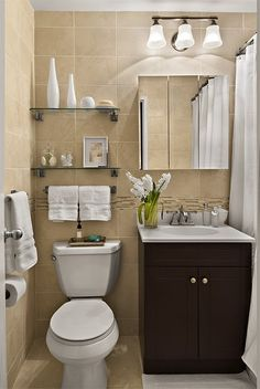 The shelves with the towel rack underneath is a great way to maximize space!
