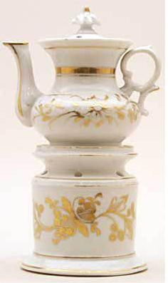 Teapot #409  Shapely squatty white with much gold on stand and pot, crescent on handle.  Acquired in Nimes
