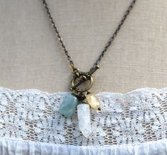 This necklace is your invitation to set down what no longer serves you. It includes an aquamarine for courage, an ice quartz crystal for healing, clarifying, and purifying, and a citrine oval for dispelling negative energy.