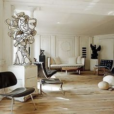The former apartment of Frederic Mechiche.. Decorated with a Jean Dubuffet sculpture (amongst many works of art) a pair of Charles and Ray Eames 'LCM' chairs, a pair of Ludwig Mies van der Rohe 'Barcelona' chairs, a Isamu Noguchi coffee table and a Poul Kjaerholm 'PK91' stool. #fredericmechiche #jeandubuffet #eames #ludwigmiesvanderrohe #isamunoguchi #poulkjaerholm #galeriedemini