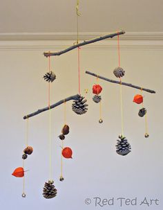 use sticks and pinecones to make a mobile