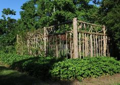 Make your vegetable garden beautiful and deer proof. This is fabulous! I love how the surrounding ground cover is all strawberries. That many would yield a great little harvest. Jam anyone?