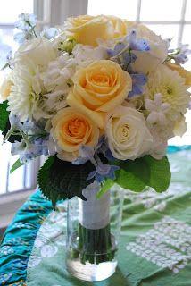 Blue orange flower arrangement from Botanica
