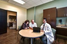Talking rooms with shared exam rooms encourage doctor/patient interaction. The rooms are large enough for family to be part of the patients care. Photographer: Dustin Revella
