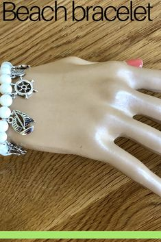 Sea / Beach Lover Charm Bracelet and Mermaid Pendent, sea shell beads and tibetan silver charms, medium size Beach Bracelets, Sea Theme, Beach Accessories, Silver Charms, Starfish, Sea Shells, Handmade Jewelry, Mermaid, Charmed