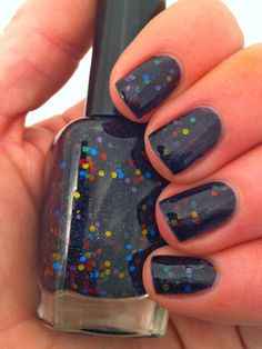 "Nail polish - ""Muted madness"" rainbow glitter in a black base. $10.00, via Emily De Molly on Etsy."
