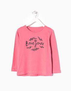T-shirt manga comprida com estampado à frente para menina. Etiqueta estampada.