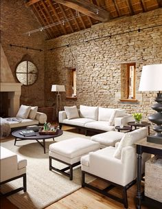 Stacked stone living room with vaulted ceilings and contemporary furniture.