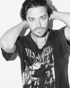 "Tom Payne on Instagram: ""Shot from earlier this year by @aurelienlevitan #DAMAGEDMAGAZINE #GnR"""