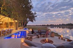 Chinzombo Safari CampNestled in 60 acres of private land, in Zambia's wild Luangwa Valley, Chinzombo is a stunning riverside safari camp with 6 luxurious villas and an exquisite spa. Outdoor Spaces, Outdoor Living, Outdoor Decor, Safari, Top 15, Time And Tide, Fine Hotels, Wooden Decks, Luxury Accommodation