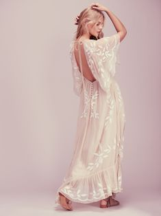 Enchanted Forest Maxi Dress | This ethereal maxi dress was made for enchanted evenings. Featured in a sheer chiffon with beautiful floral applique detailing and bead accents and a super femme ruffle hem. Square neckline with statement sleeves and a low back with delicate button closures and an adjustable tie at the back neck. Hidden side zip. Lined.