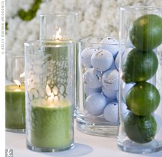 back to results  popular searches  The Ceremony Decor        Email      Print    Three green candles, a cylinder of limes, and a vase full of golf balls -- a tribute to Gutherie's golf skills -- decorated the unity candle table