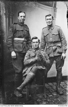 Group portrait of three unidentified Australian soldiers, possibly from a Light Trench Mortar battery. The soldier seated in the front holds a kitten. From the Thuillier collection of glass plate