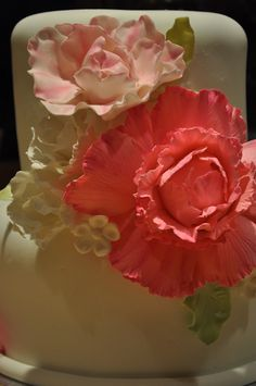 - Fondant covered wedding cake with gumpaste peonies, filler flowers and leaves.