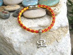 Leather Inspirational bracelet ~ with Indalo charm.  Fun, meaningful jewellery that encourages good fortune. This colourful leather bracelet, made in Spain, features the figure of the lucky Indalo which originates in Andalucía, southern Spain - where even today small village pueblos lie hidden behind the giant sierras that roll down to the Mediterranean shores, and the Indalo is known for its magical powers and is a symbol of protection and good fortune.