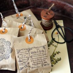 print on paper bags, punch hole, add reinforcement sticker and twine. great idea for packaging small items like soap, or just for decor.