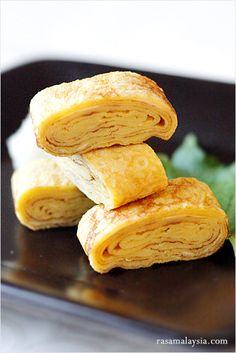 Japanese Rolled Omelet (Tamagoyaki) recipe - This is a slightly sweet but delicate omelet that is often packed into Japanese bento boxes and also served at sushi bars as tamago nigiri. The taste is utterly delicious! Bento Recipes, Cooking Recipes, Bento Ideas, Game Recipes, Meatball Recipes, Cooking Tips, Chicken Recipes, Recipies, Tamagoyaki Recipe