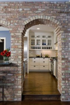 Brick Kitchen arch...love it! I shall add it to my never ending list of things i want in my dream home lol