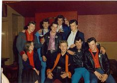A group of Leeds Teddy Boys in the late 1970's showing the different coloured velvets, use of roll colours and half-moon pockets which were very popular at the time.  Note many Teddy Boys at this time would also wear Leather Jackets which were a spin off from the Rockers of the 1960's.