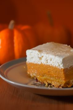 pumpkin crunch cake 1 can (29 oz) pumpkin 1 can (13 oz) evaporated milk 1 c sugar 3 eggs 1 tsp cinnamon 1 box Duncan Hines yellow cake mix 1 c pecans, chopped 1 c butter, melted 8 oz cream cheese, softened 8 oz Cool Whip 1 c sifted powdered sugar