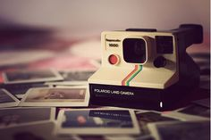 Get a polaroid camera and take one picture everyday for a year