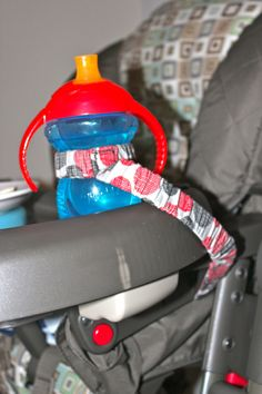 Tether Leash Strap Holder: MULTIPLE USES- Sippy Cup, Bottle, Toy, Pacifier, Binky, Blanket, Sophie the Giraffe, clothing, ANYTHING. $10.00, via Etsy.